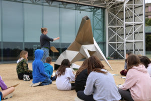 Artist Genevieve Rudd leading a workshop outside the Sainsbury Centre for Visual Arts